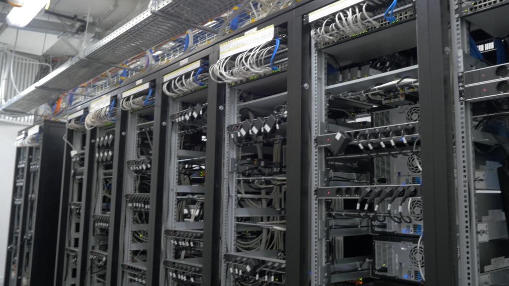 bitcoin miners set up on wired shelfs