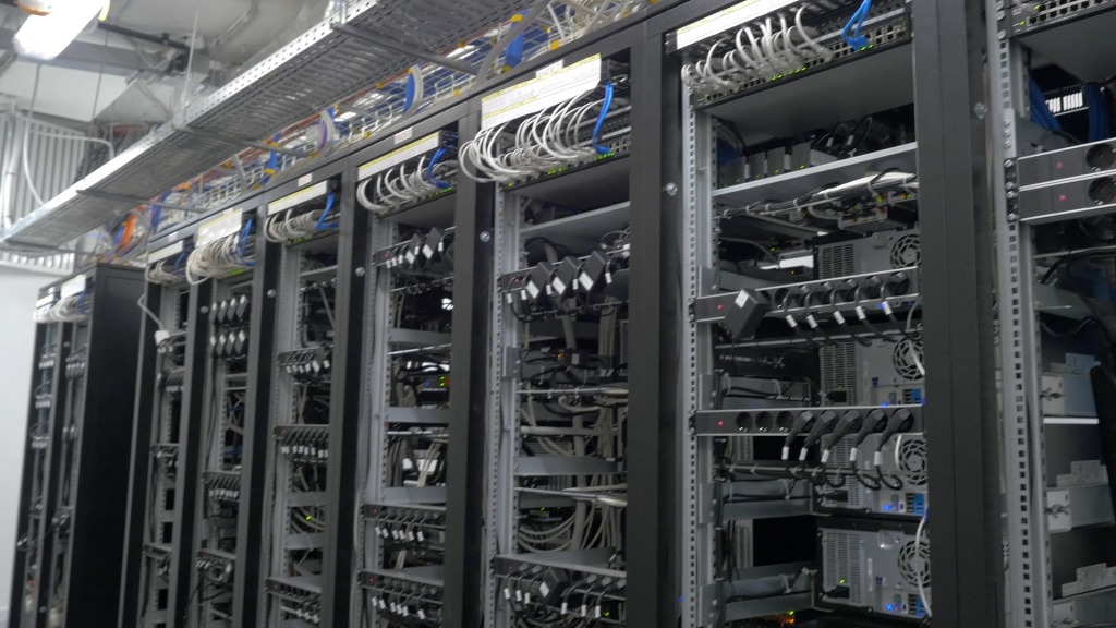 bitcoin miners set up on wired shelfs